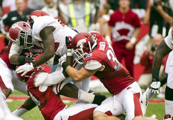 Sep 15, 2012; Fayetteville, AR, USA; Alabama Crimson Tide running back Eddie Lacy (42) gets past Arkansas Razorback safety Eric Bennett (14) and fullback Morgan Linton (35) to score a touchdown during the first half at Donald W. Reynolds Razorback Stadium