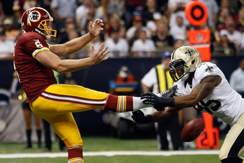 NEW ORLEANS, LA - SEPTEMBER 09:  Martez Wilson #95 of the New Orleans Saints blocks a punt by Sav Rocca #6 of the Washington Redskins  at Mercedes-Benz Superdome on September 9, 2012 in New Orleans, Louisiana.  (Photo by Chris Graythen/Getty Images)