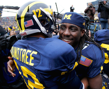 Roy Roundtree and Denard Robinson share a tender moment in 2011.