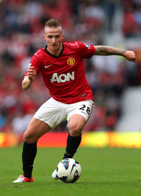 MANCHESTER, ENGLAND - SEPTEMBER 15:  Alexander Buttner of Manchester United runs with the ball during the Barclays Premier League match between Manchester United and Wigan Athletic at Old Trafford on September 15, 2012 in Manchester, England.  (Photo by A