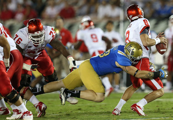 UCLA DE Cassius Marsh sacks Houston QB David Piland to spark the Bruins to a 37-6 victory.