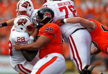 Oregon State DT Castro Masaniai stuffs Wisconsin RB Montee Ball.