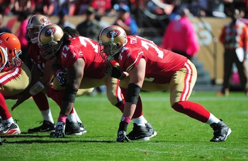 Mike Iupati, (77), and Joe Staley anchor the left side of the offensive line