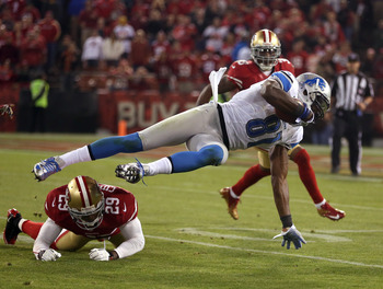 Calvin Johnson is upended by 49ers' DB Chris Culliver