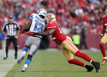 Patrick Willis makes a textbook tackle on Nate Burleson