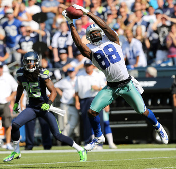 SEATTLE, WA - SEPTEMBER 16:  Wide receiver Dez Bryant #88 of the Dallas Cowboys just misses making a catch against the Seattle Seahawks at CenturyLink Field on September 16, 2012 in Seattle, Washington.  (Photo by Otto Greule Jr/Getty Images)