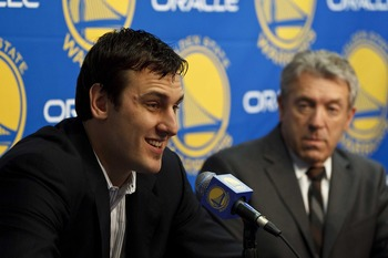 Andrew Bogut will bring a presence to the frontcourt.