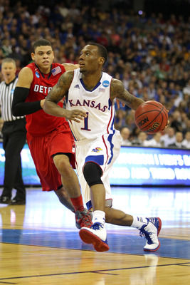 Kansas sophomore guard Naadir Tharpe was inconsistent as a freshman but may see increased minutes without a true point guard on the Jayhawks roster.