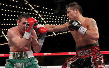 Martinez (right) is pictured in a fight where he defeated the bigger opponent in Matthew Macklin (left).
