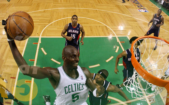 Garnett goes in for 2 of his 18 points over Josh Smith