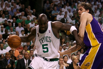 Garnett drives past Pau Gasol