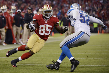 Vernon Davis eludes a Lion defender on his way to a touchdown