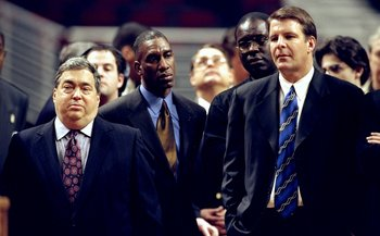 See the long faces of Krause [L] and Tim Floyd? You don't want to repeat the 2000 debacle.