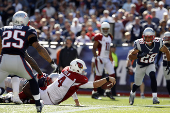 Kevin Kolb reaches for the goal line against New England.