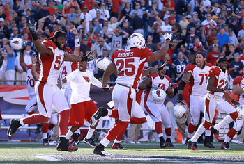 The Cardinals sprint onto the field to celebrate the win over New England.