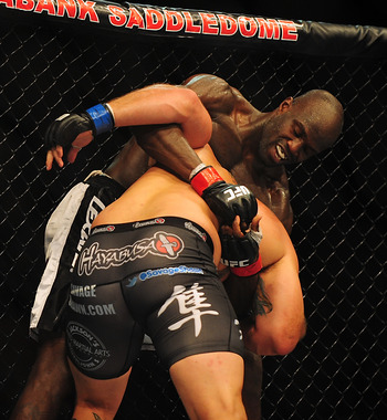 Jul 21, 2012; Calgary, AB, CANADA; Shawn Jordan (blue gloves) and Cheick Kongo (red gloves) during the heavyweight bout of UFC 149 against at the Scotiabank Saddledome. Mandatory Credit: Anne-Marie Sorvin-US PRESSWIRE