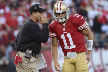 Jim Harbaugh gives Alex Smith some information