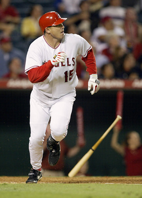 ANAHEIM, CA - SEPTEMBER 23:  Tim Salmon #15 of the Anaheim Angels hits a walk off home run in the 11th inning to beat the Seattle Mariners 2-1 during their game on September 23, 2003 at Edison Field in Anaheim, California.  (Photo by Jeff Gross/Getty Imag