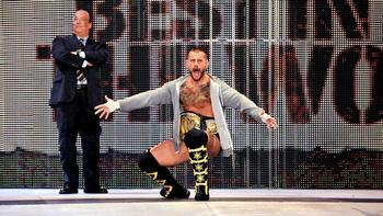 CM Punk makes his entrance alongside Paul Heyman.