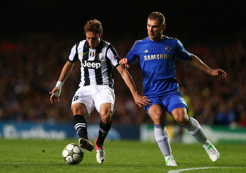 LONDON, ENGLAND - SEPTEMBER 19:  Claudio Marchisio of Juventus and Branislav Ivanovic of Chelsea battle for the ball uring the UEFA Champions League Group E match between Chelsea and Juventus at Stamford Bridge on September 19, 2012 in London, England.  (