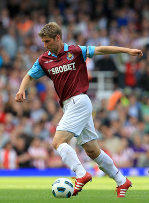 Thomas Hitzlsperger, shown here with West Ham United, is a free agent after Wolfsburg terminated his contract.