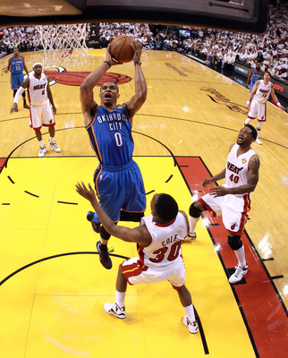 MIAMI, FL - JUNE 21:  Russell Westbrook #0 of the Oklahoma City Thunder drives for a shot attempt against Norris Cole #30 of the Miami Heat in Game Five of the 2012 NBA Finals on June 21, 2012 at American Airlines Arena in Miami, Florida. NOTE TO USER: Us