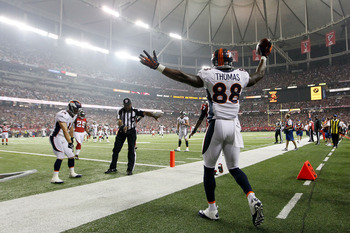 ATLANTA, GA - SEPTEMBER 17:  Wide receiver Demaryius Thomas #88 of the Denver Broncos celebrates after scoring a touchdown in the second quarter against the Atlanta Falcons during a game at the Georgia Dome on September 17, 2012 in Atlanta, Georgia.  (Pho