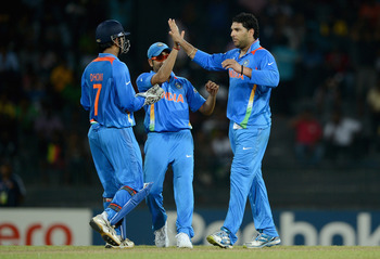 India celebrating its narrow victory over Afghanistan.