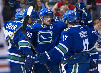 VANCOUVER, CANADA - APRIL 7: Henrik Sedin #33 of the Vancouver Canucks celebrates with Alexander Edler #23 and Ryan Kesler #17 after scoring a power play goal against the Edmonton Oilers during the second period in NHL action on April 07, 2012 at Rogers A