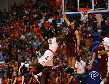 SYRACUSE, NY - NOVEMBER 19:  Rakeem Christmas #25 of the Syracuse Orange dives as he shoots the ball against John Brandenburg #3 of the Colgate Raiders during the game at the Carrier Dome on November 19, 2011 in Syracuse, New York.  (Photo by Nate Shron/G