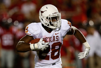 Malcolm Brown leads the Texas rushing attack against Oklahoma State Sept. 29.