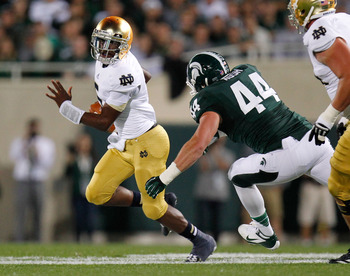 QB Everett Golson avoids Michigan State's Marcus Rush (44)