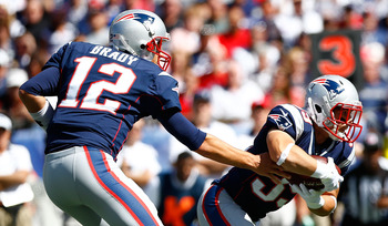 FOXBORO, PA - SEPTEMBER 16: Tom Brady #12 of the New England Patriots hands the ball off to teammate Danny Woodhead #39 against Arizona Cardinals during the game on September 16, 2012 at Gillette Stadium in Foxboro, Massachusetts.  (Photo by Jared Wickerh