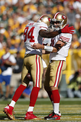 A welcome embrace after an Alex Smith to Randy Moss TD.