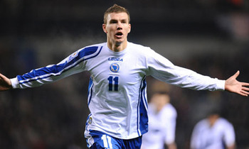 Edin Dzeko celebrates with the Bosnia-Herzegovina national football team