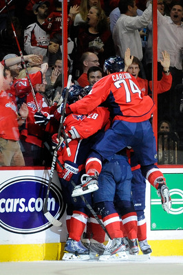 Capitals players fighting each other for the last Hershey Bears ticket.