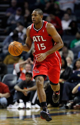 CHARLOTTE, NC - JANUARY 06:  Al Horford #15 of the Atlanta Hawks against the Charlotte Bobcats during their game at Time Warner Cable Arena on January 6, 2012 in Charlotte, North Carolina.  NOTE TO USER: User expressly acknowledges and agrees that, by dow