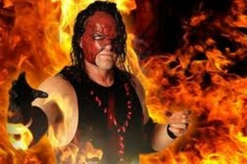Kane is on fire. Image by WWE