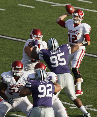 MANHATTAN, KS - OCTOBER 29:  Quarterback Landry Jones #12 of the Oklahoma Sooners passes during a game against the Kansas State Wildcats in the third quarter at Bill Snyder Family Stadium on October 29, 2011 in Manhattan, Kansas. Oklahoma won 58-17. (Phot