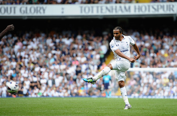 LONDON, ENGLAND - AUGUST 25:  Benoit Assou-Ekotto of Tottenham Hotspur scores the opening goal during the Barclays Premier League match between Tottenham Hotspur and West Bromwich Albion at White Hart Lane on August 25, 2012 in London, England.  (Photo by