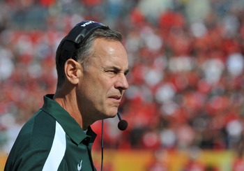 TAMPA, FL - JANUARY 02: Coach Mark Dantonio of the Michigan State Spartans watches play against the Georgia Bulldogs in the Outback Bowl January 2, 2012 at Raymond James Stadium in Tampa, Florida. (Photo by Al Messerschmidt/Getty Images)