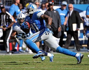NASHVILLE, TN - SEPTEMBER 23:  Ryan Mouton #29 of the Tennessee Titans watches wide receiver Calvin Johnson #81 of the Detroit Lions run after catching a pass at LP Field on September 23, 2012 in Nashville, Tennessee.  (Photo by Frederick Breedon/Getty Im