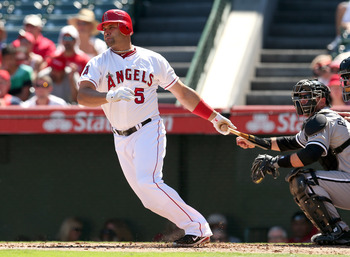 ANAHEIM, CA - SEPTEMBER 23:  Albert Pujols #8 of the Los Angeles Angels of Anaheim hits a single the first inning against the Chicago White Sox at Angel Stadium of Anaheim on September 23, 2012 in Anaheim, California.  The Angels won 4-1.  (Photo by Steph