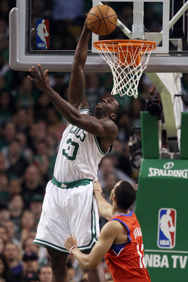BOSTON, MA - MAY 12:  Brandon Bass #30 of the Boston Celtics takes a shot as Evan Turner #12 of the Philadelphia 76ers defends in Game One of the Eastern Conference Semifinals in the 2012 NBA Playoffs on May 12, 2012 at TD Garden in Boston, Massachusetts.