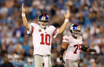 CHARLOTTE, NC - SEPTEMBER 20:  Eli Manning #10 of the New York Giants celebrates after a touchdown against the Carolina Panthers during their game at Bank of America Stadium on September 20, 2012 in Charlotte, North Carolina.  (Photo by Streeter Lecka/Get