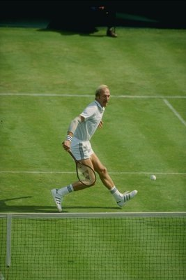 Stan Smith on the grass at Wimbledon