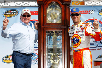 MARTINSVILLE, VA - MARCH 31:  Kevin Harvick, driver of the #2 Tide/Kroger Chevrolet, and team owner Richard Childress celebrate with the grandfather clock trophy in Victory Lane after winning the NASCAR Camping World Truck Series Kroger 250 at Martinsvill