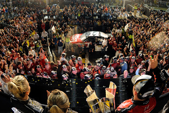 HOMESTEAD, FL - NOVEMBER 20:  Tony Stewart, driver of the #14 Office Depot/Mobil 1 Chevrolet, celebrates with the Championship trophy in Victory Lane after winning the NASCAR Sprint Cup Series Ford 400 and the 2011 Series Championship at Homestead-Miami S