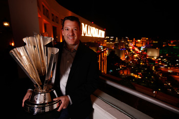 LAS VEGAS, NV - NOVEMBER 29:  2011 Series Champion Tony Stewart poses with his trophy at the House of Blues Foundation Room inside Mandalay Bay Resort & Casino during the NASCAR Sprint Cup Series Champion's Week on November 29, 2011 in Las Vegas, Nevada.