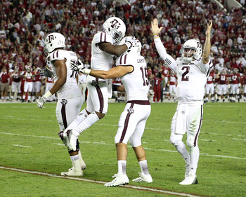 TUSCALOOSA, AL - NOVEMBER 10:  Quarterback Johnny Manziel #2 of the Texas A&M Aggies (right) celebrates with other teammates during the game against the Alabama Crimson Tide at Bryant-Denny Stadium on November 10, 2012 in Tuscaloosa, Alabama.  (Photo by M